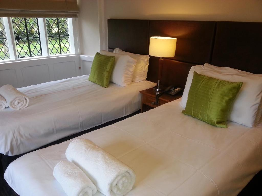 A bed or beds in a room at Thornbury Lodge