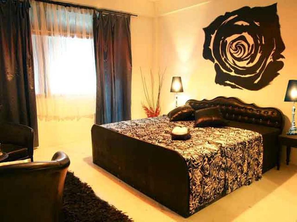 Un ou plusieurs lits dans un hébergement de l'établissement Room@Bangkok Boutique Guesthouse