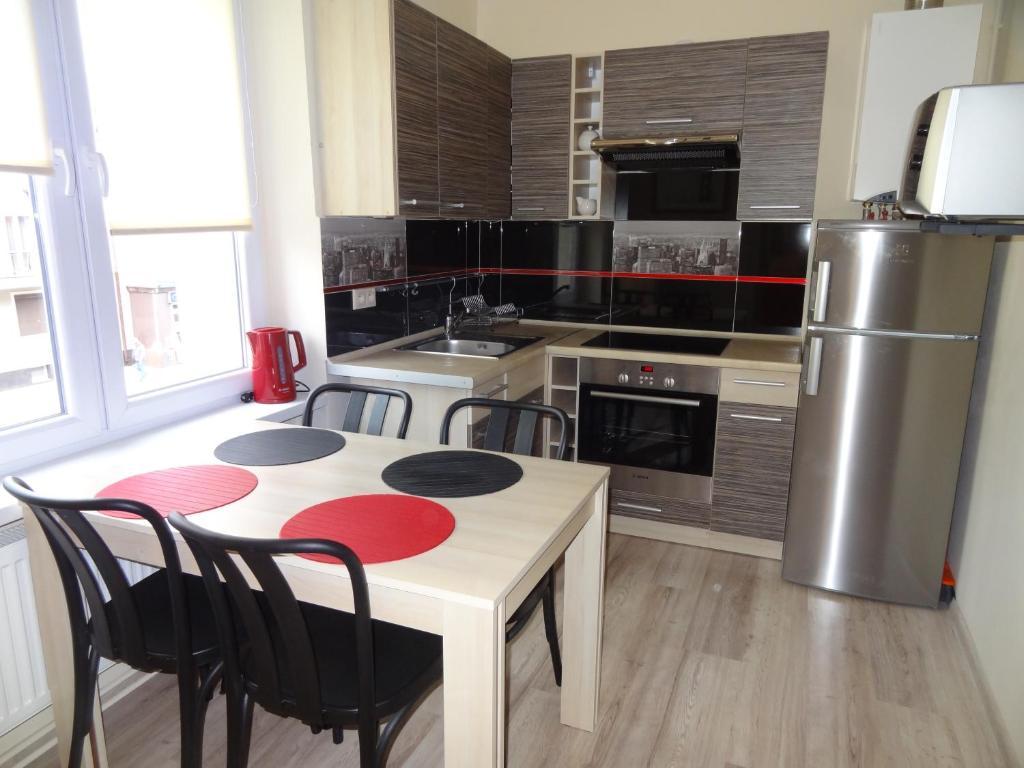 A kitchen or kitchenette at Sopot City Apartament
