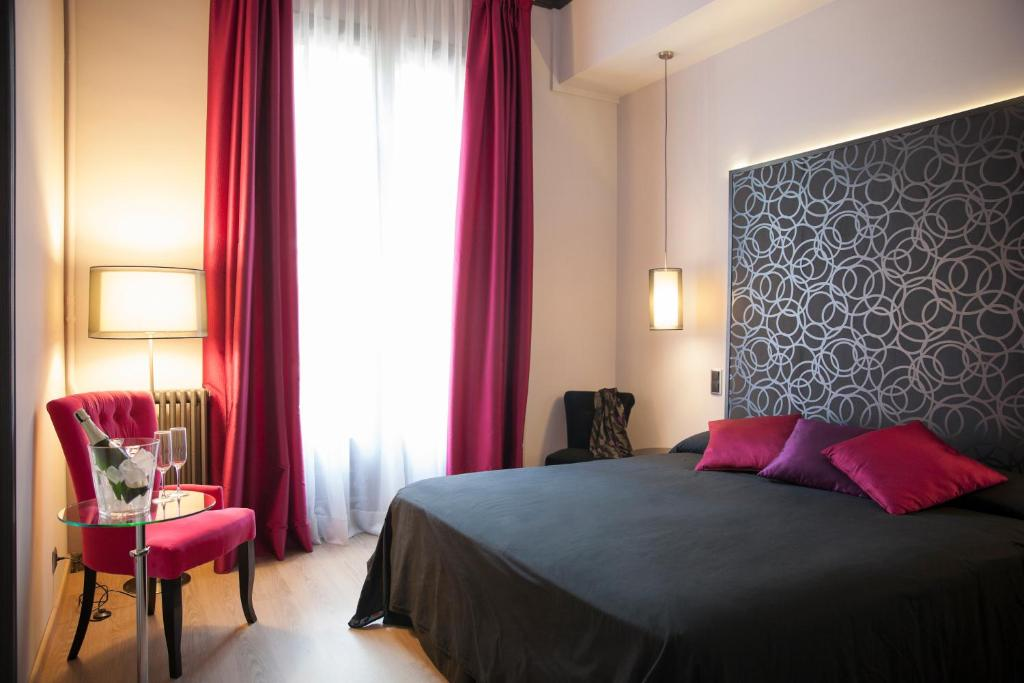 A bed or beds in a room at Umma Barcelona B&B Boutique