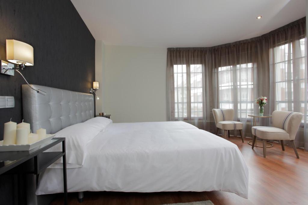 Cama o camas de una habitación en Hotel Rosal