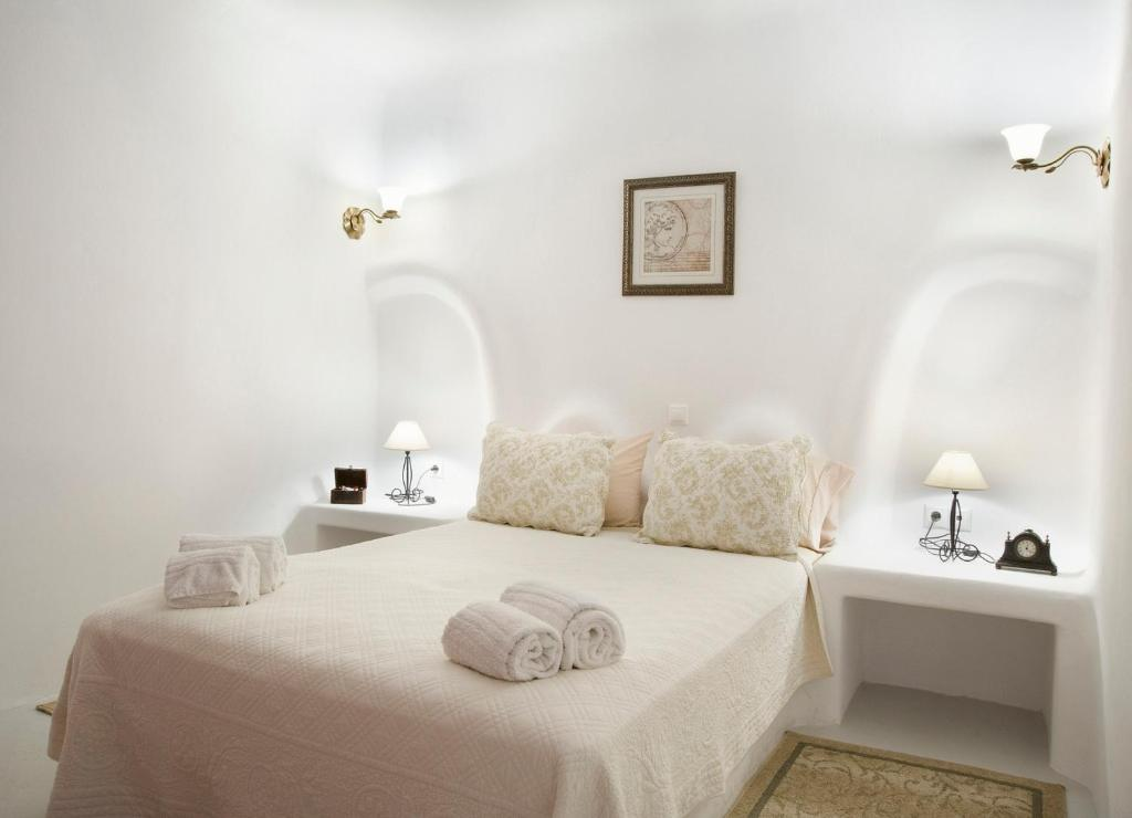 A bed or beds in a room at Eleni's Village Suites