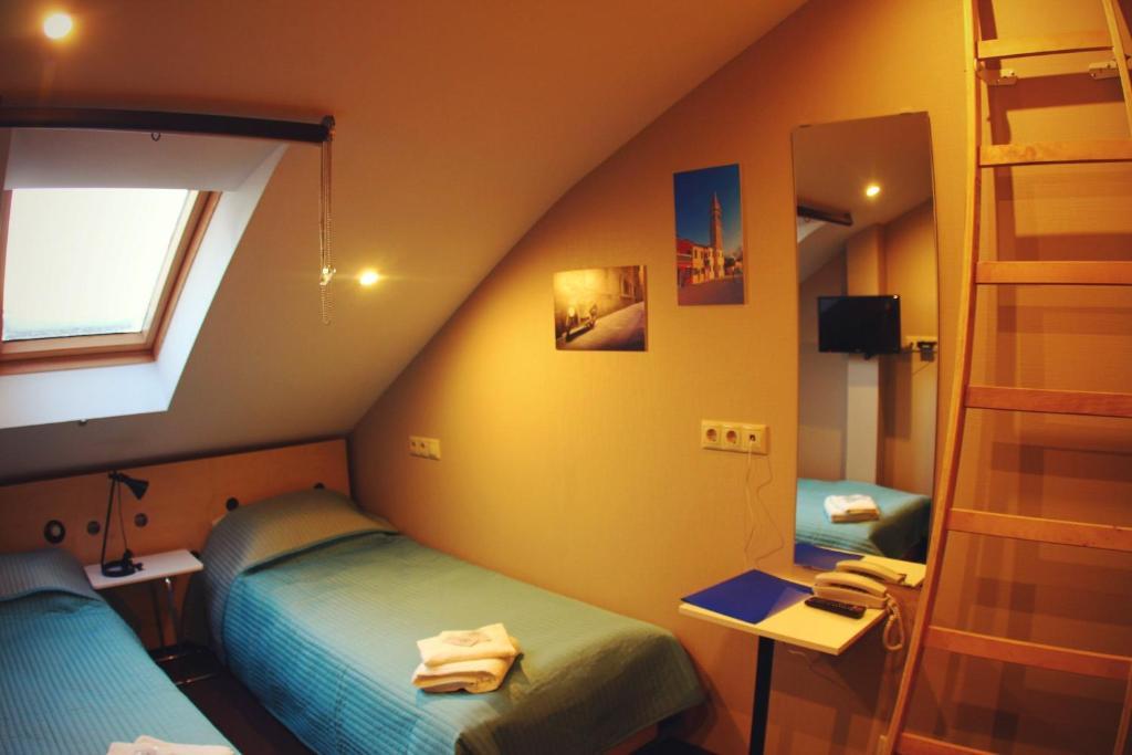 Кровать или кровати в номере Отель Литали