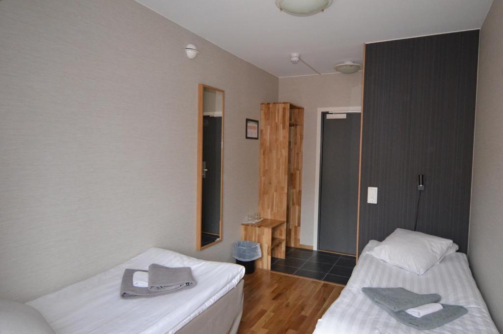 Postel nebo postele na pokoji v ubytování Hotell Svanen