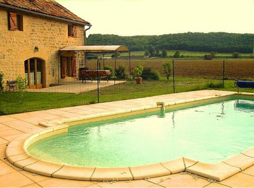 The swimming pool at or near Gite Chez Theophile