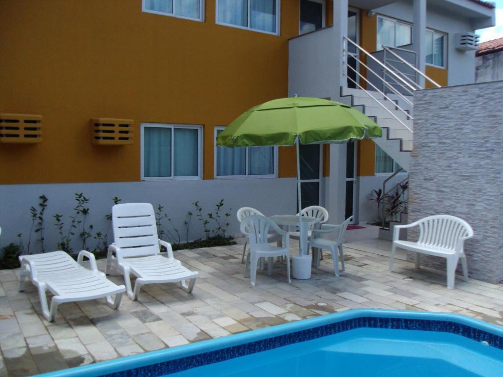 The swimming pool at or near Flat Porto dos Carneiros