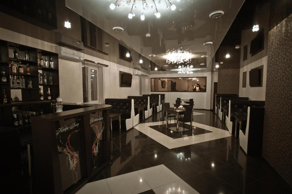 A restaurant or other place to eat at Elyzium Hotel Complex