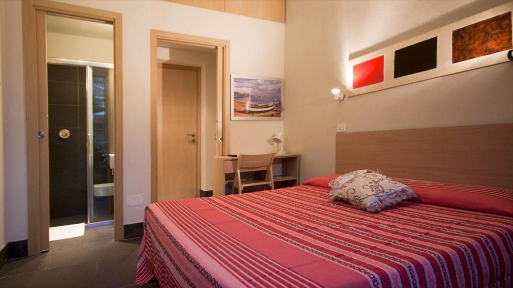 A bed or beds in a room at La sella del diavolo