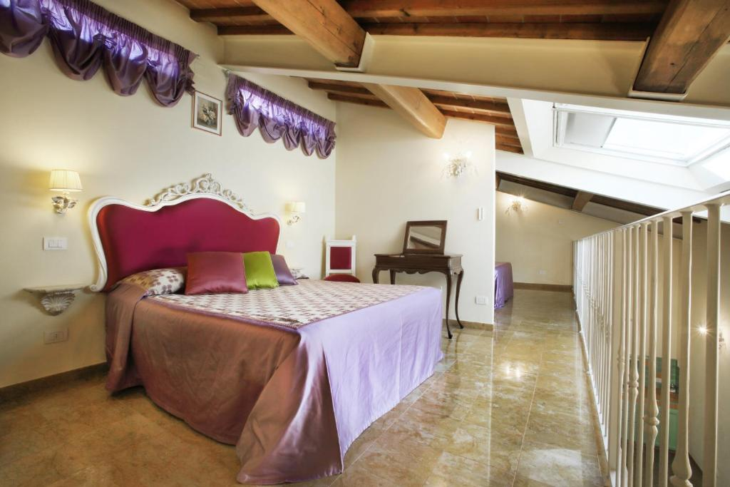 A bed or beds in a room at Villa Lucrezia