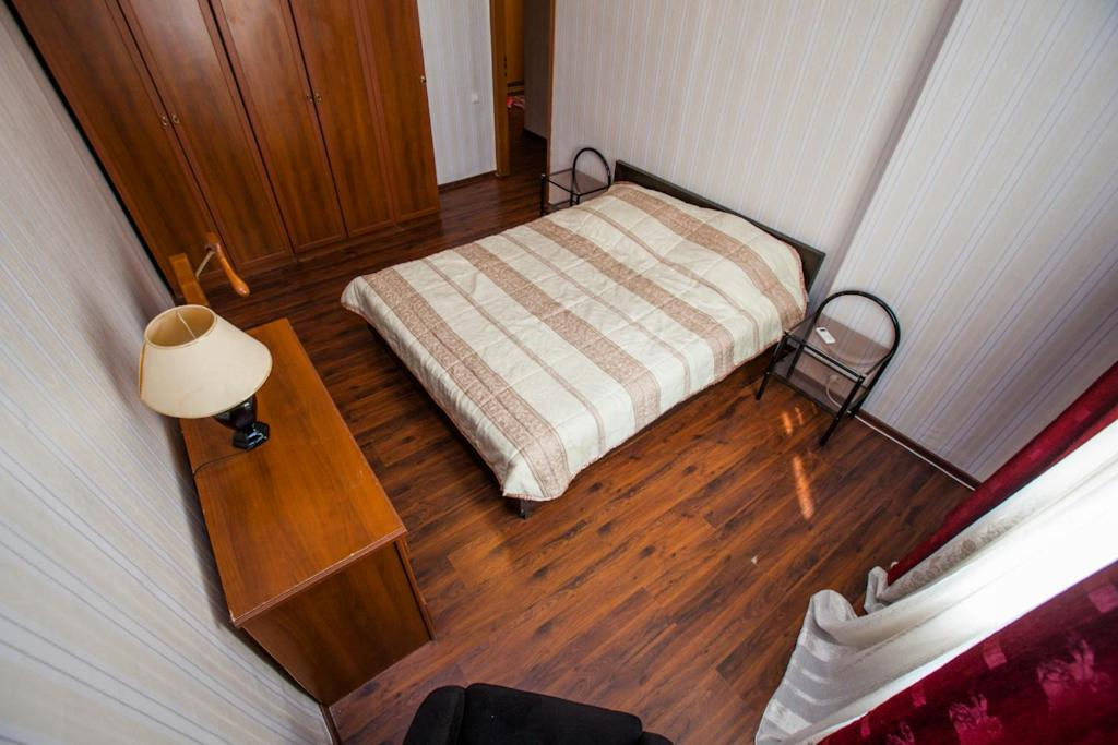 A bed or beds in a room at Standard Brusnika Apartments Krasnoselskaya