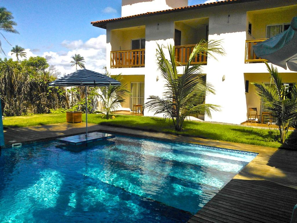 The swimming pool at or near Pousada do Holandes Bahia