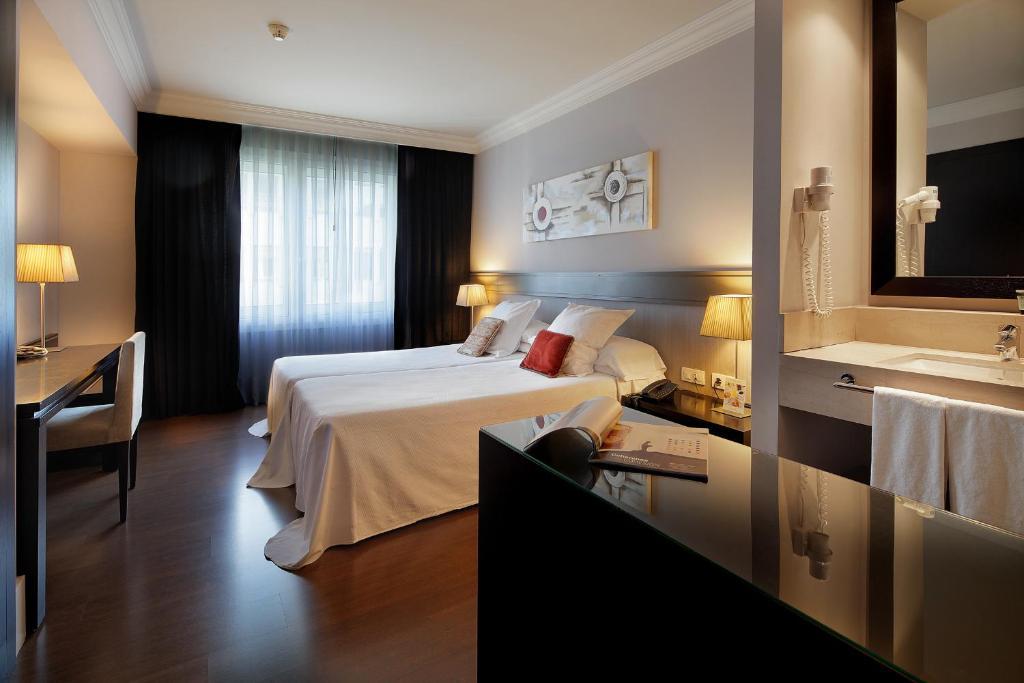 Letto o letti in una camera di Hotel Condado
