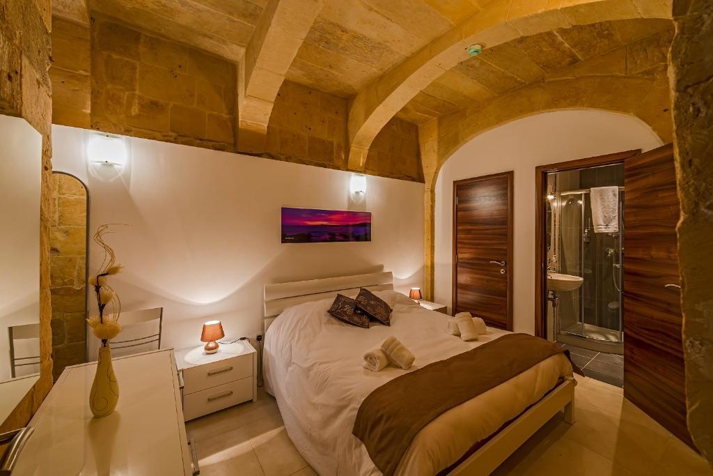 Lova arba lovos apgyvendinimo įstaigoje Valletta Merisi Suites