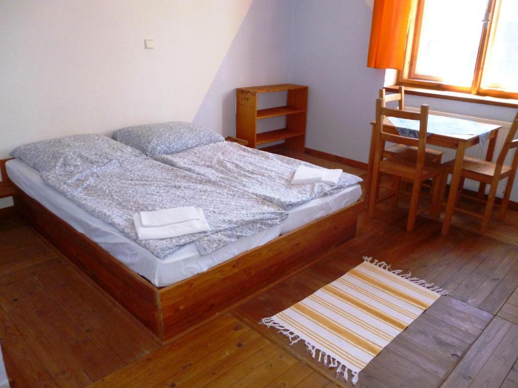 Postel nebo postele na pokoji v ubytování Švehlíkova Chata