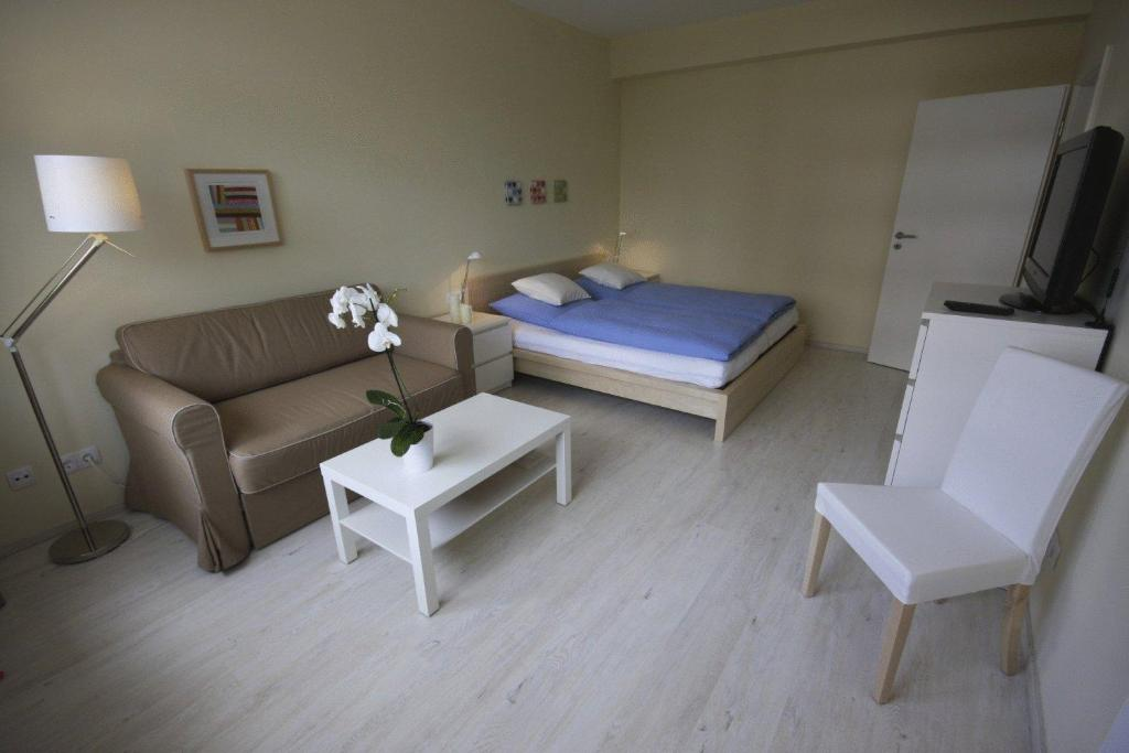 A bed or beds in a room at City Lodging Apartments