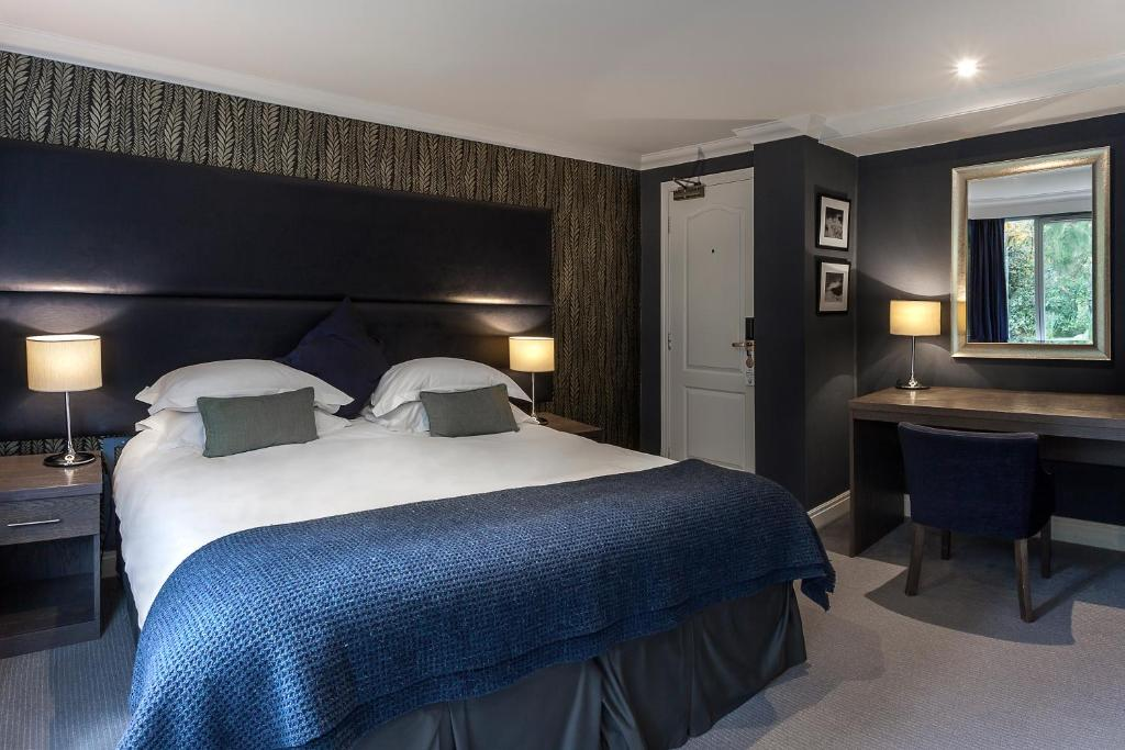 A bed or beds in a room at Langdale Hotel & Spa