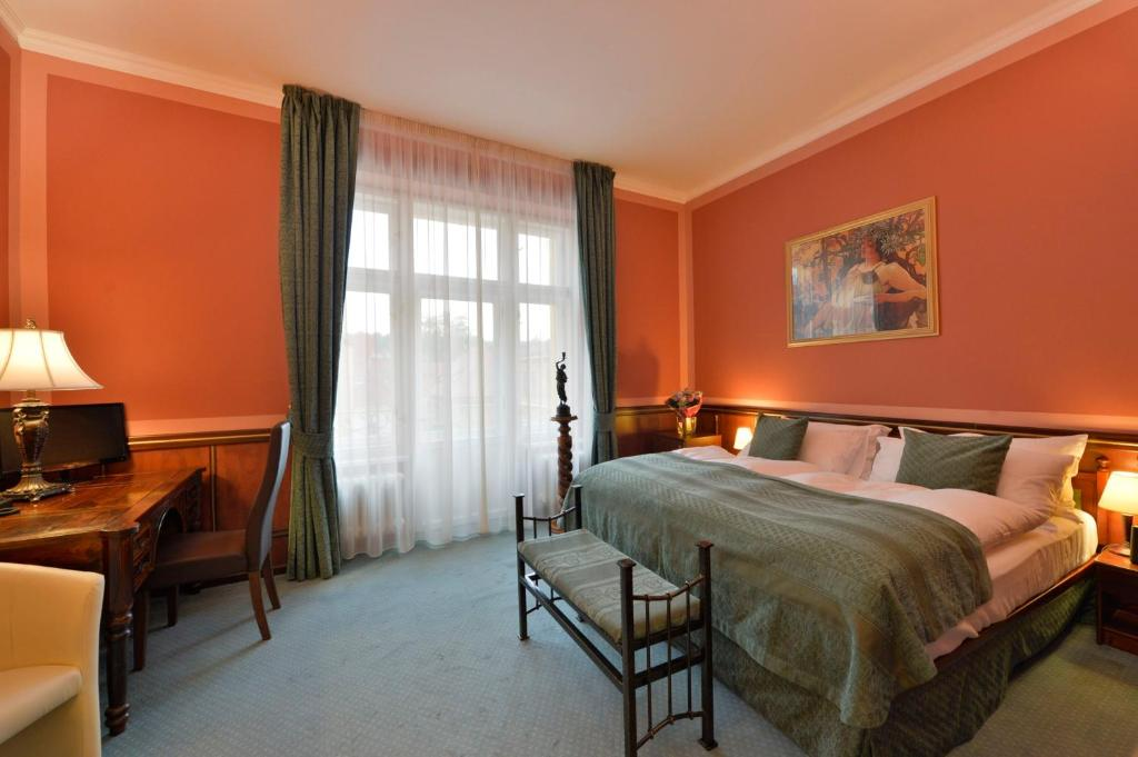 A bed or beds in a room at Hotel Hastal Prague Old Town