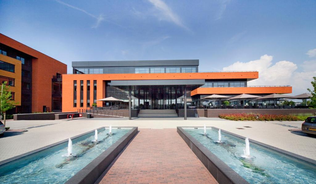 The swimming pool at or near Van Der Valk Hotel Almere