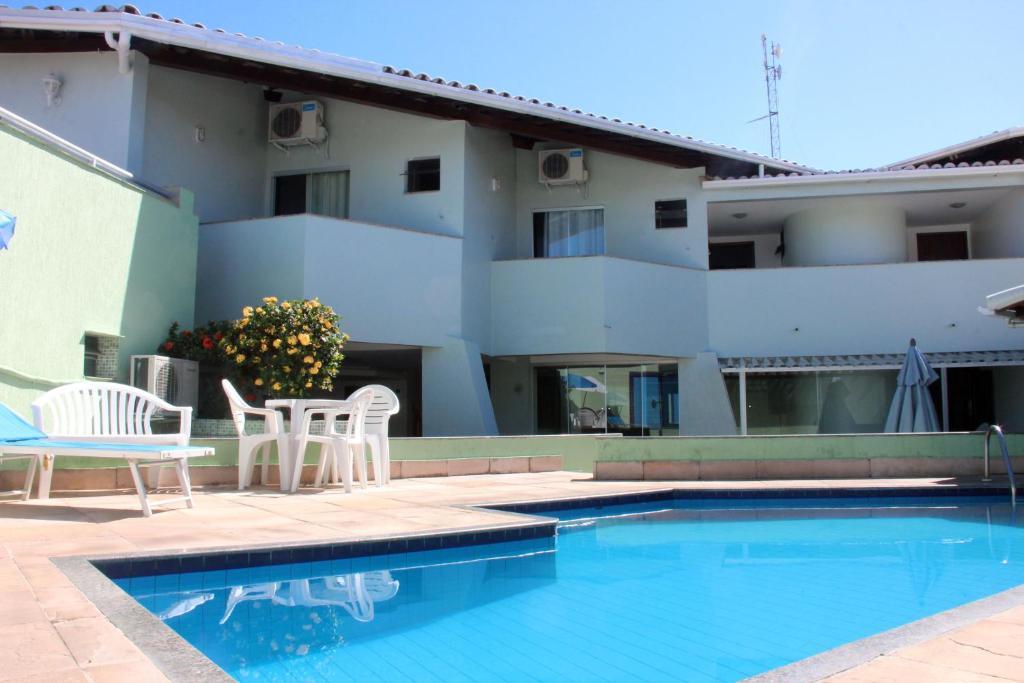 The swimming pool at or near Hotel Ponta de Areia