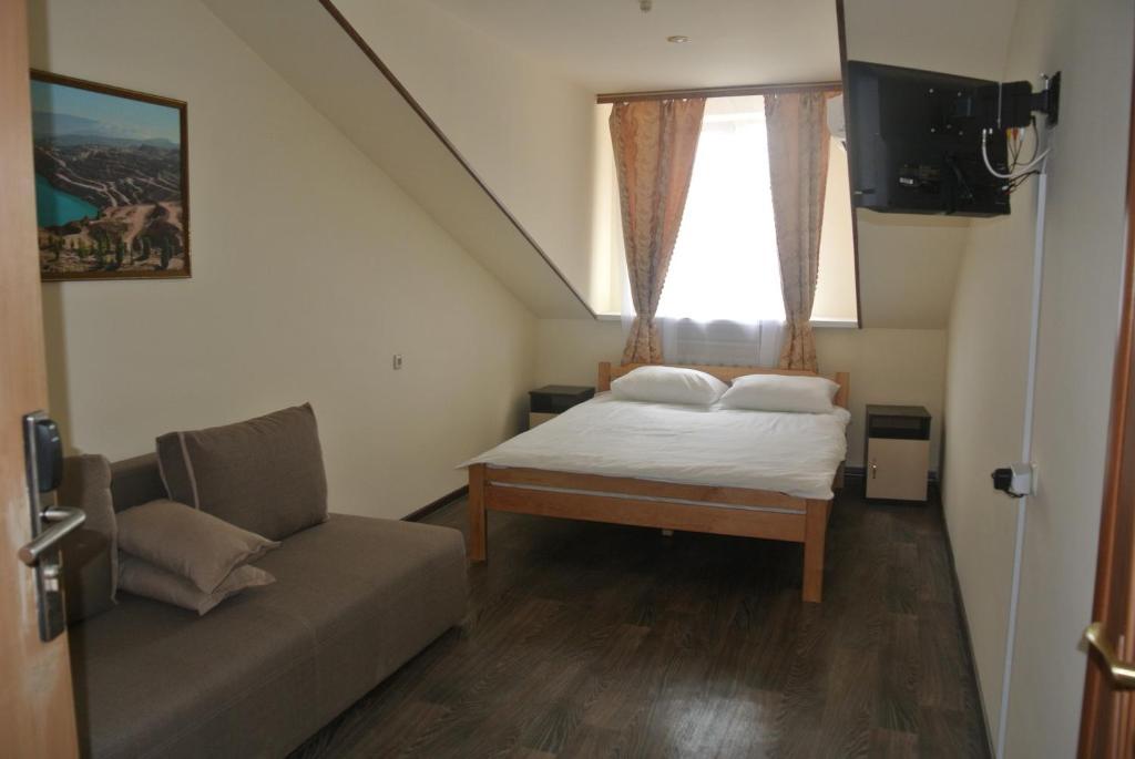 Кровать или кровати в номере Эконом Уют Мотель