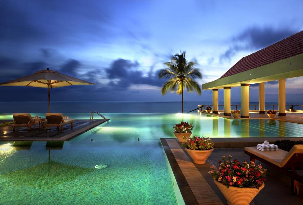 The swimming pool at or near The Leela Kovalam