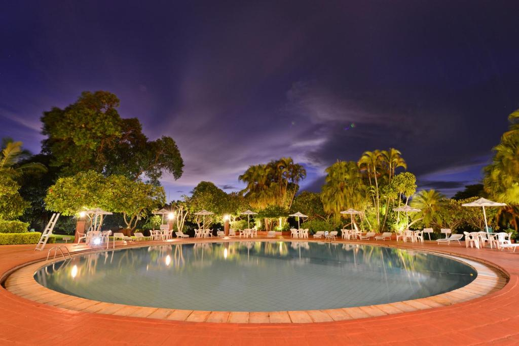 The swimming pool at or near Hotel Deville Express Guaira
