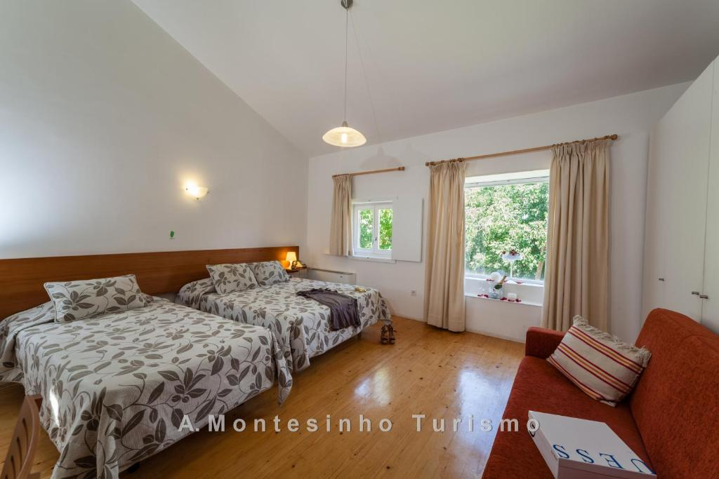 A bed or beds in a room at A. Montesinho Turismo