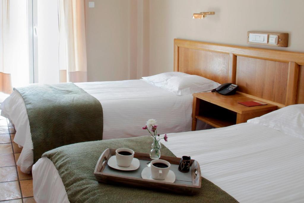 Кровать или кровати в номере Pella