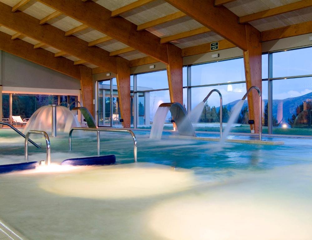 The swimming pool at or near Sercotel Hotel & Spa La Collada