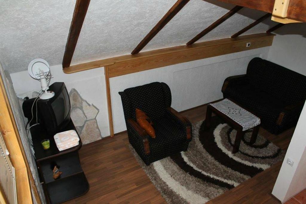 Ein Sitzbereich in der Unterkunft Apartments Vojinovic