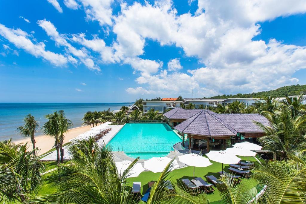 Вид на бассейн в Villa Del Sol Beach Resort & Spa или окрестностях