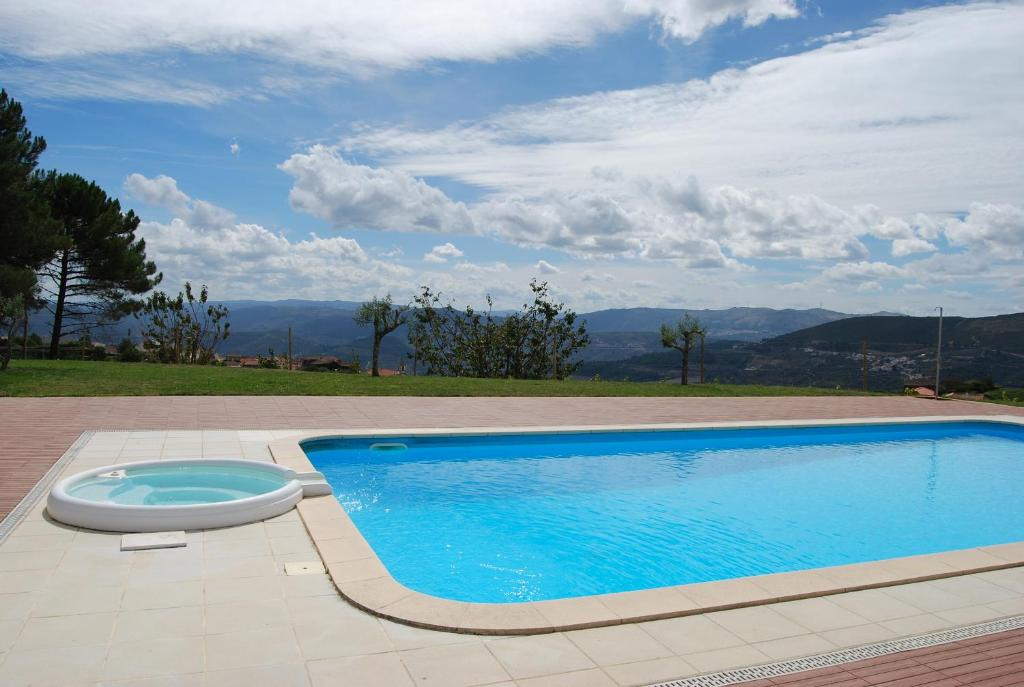 The swimming pool at or near Quinta Manhas Douro