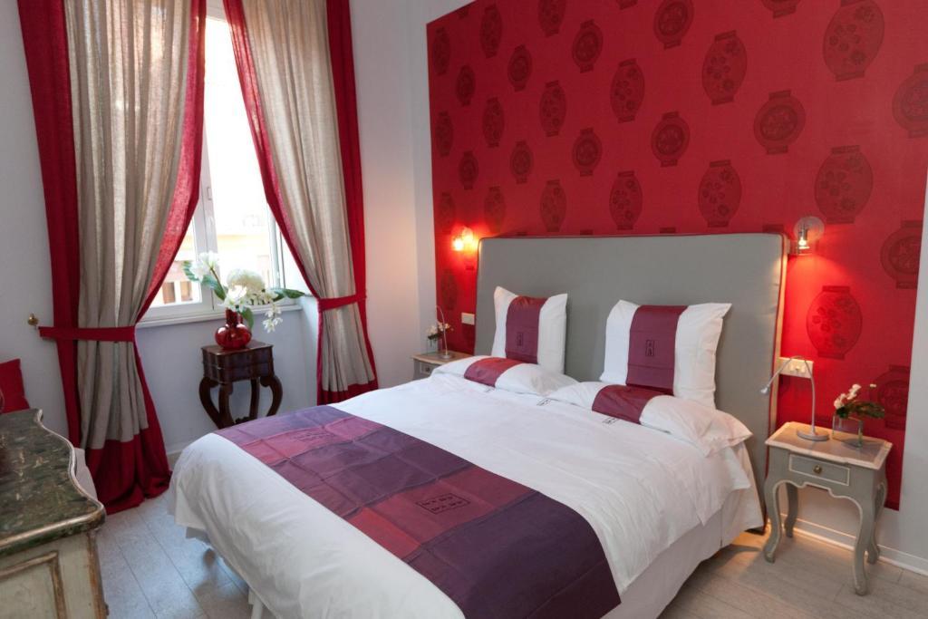 Uma cama ou camas num quarto em 66 Imperial Inn Deluxe B&B