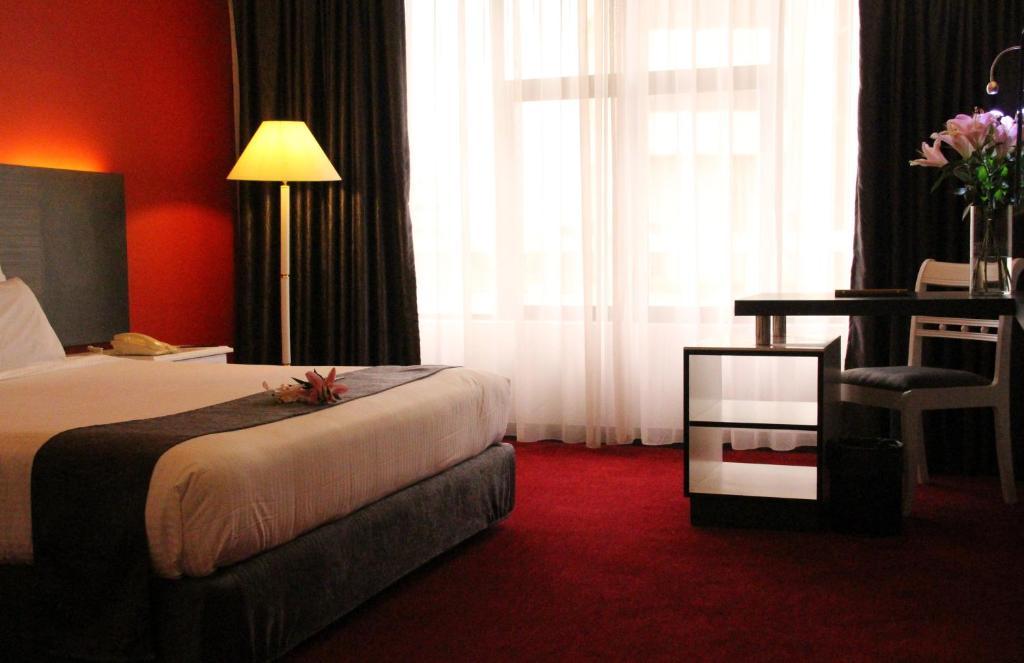 Katil atau katil-katil dalam bilik di Grand Riverview Hotel