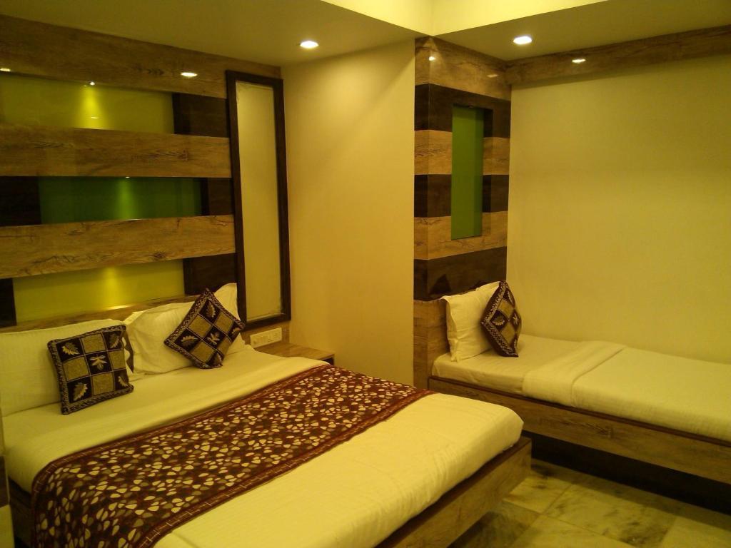 Postelja oz. postelje v sobi nastanitve Hotel Ocean Residency