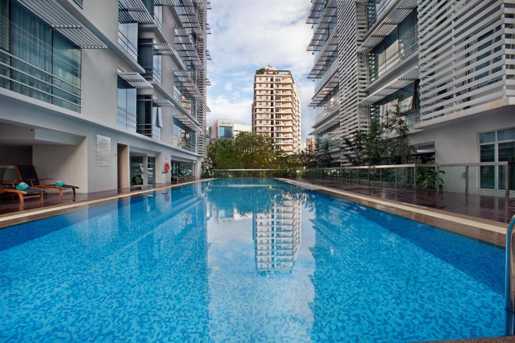 The swimming pool at or near PARKROYAL Serviced Suites Kuala Lumpur