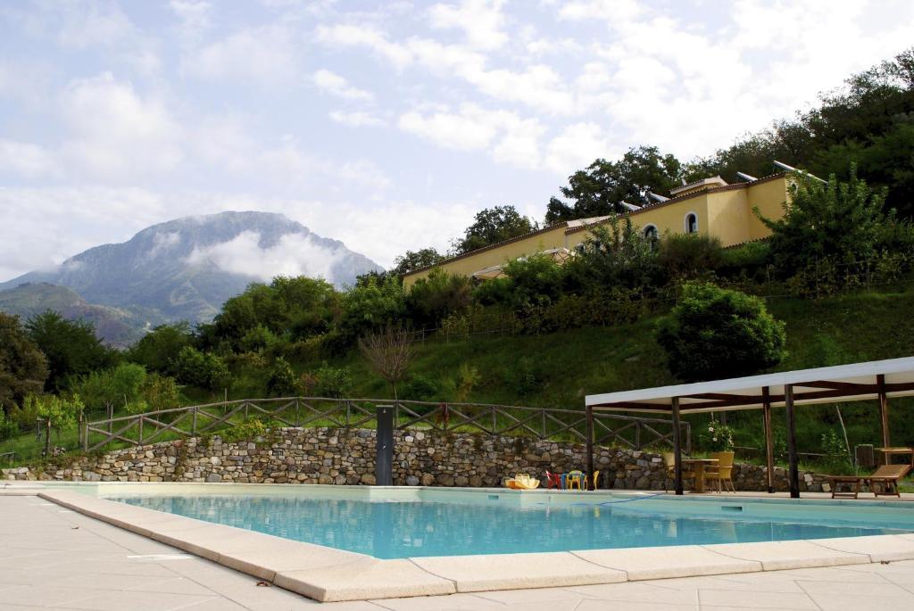 The swimming pool at or near Agriturismo L'Arca di Anna Brambilla