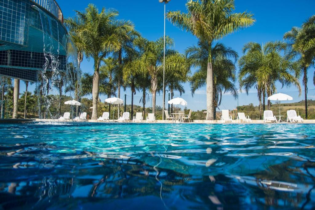 The swimming pool at or near Oscar Inn Eco Resort