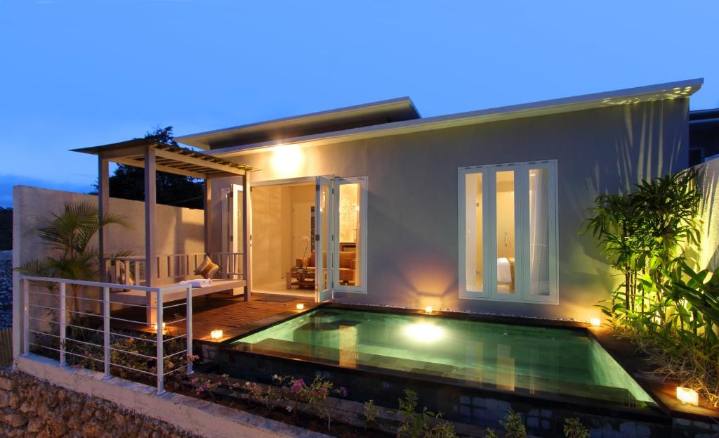 The villa sits atop a hill in the Jimbaran area and faces Tanjung, Benoa