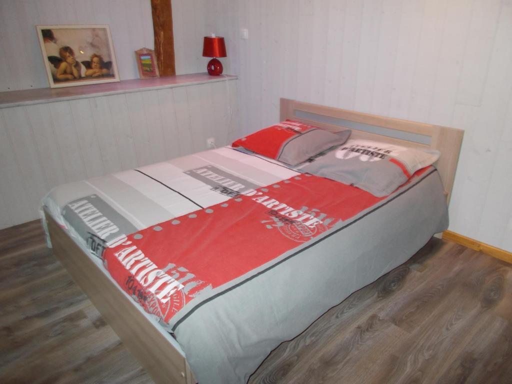 Un ou plusieurs lits dans un hébergement de l'établissement La Ferme de Genarville