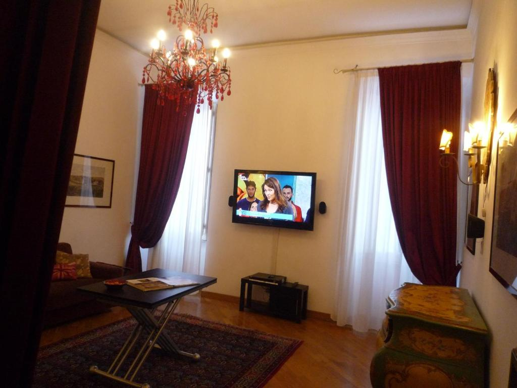 A television and/or entertainment center at Residenza Mucha