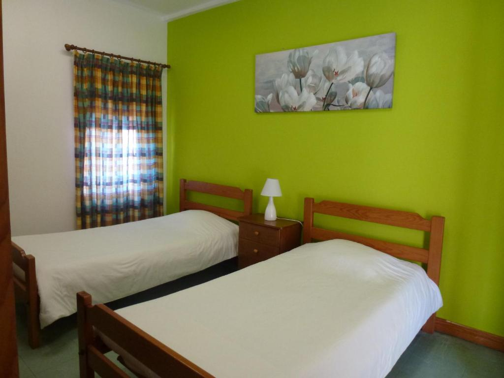 A bed or beds in a room at HI Faro – Pousada de Juventude