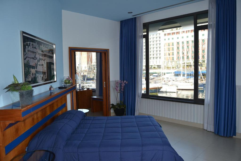 A bed or beds in a room at Hotel Transatlantico