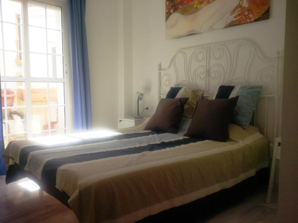 A bed or beds in a room at Apartamento centro historico