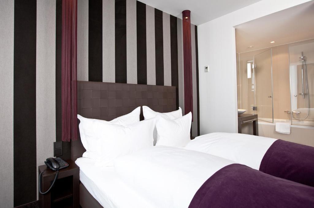 Ein Bett oder Betten in einem Zimmer der Unterkunft Goodman's Living