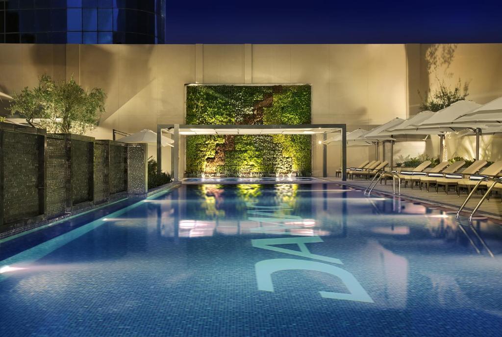 Condo hotel damac maison cour jardin dubai uae for Jardin tecina booking