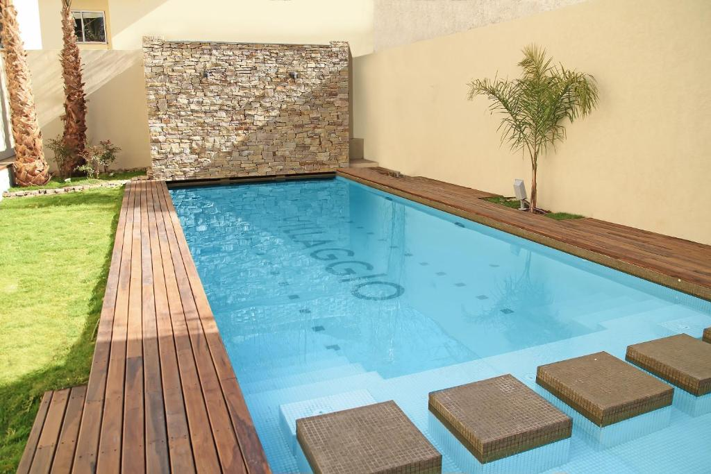 The swimming pool at or near Villaggio Hotel Boutique