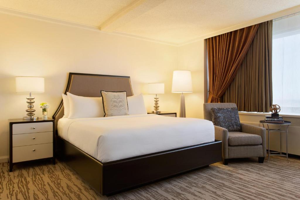 A bed or beds in a room at The Fairmont Winnipeg