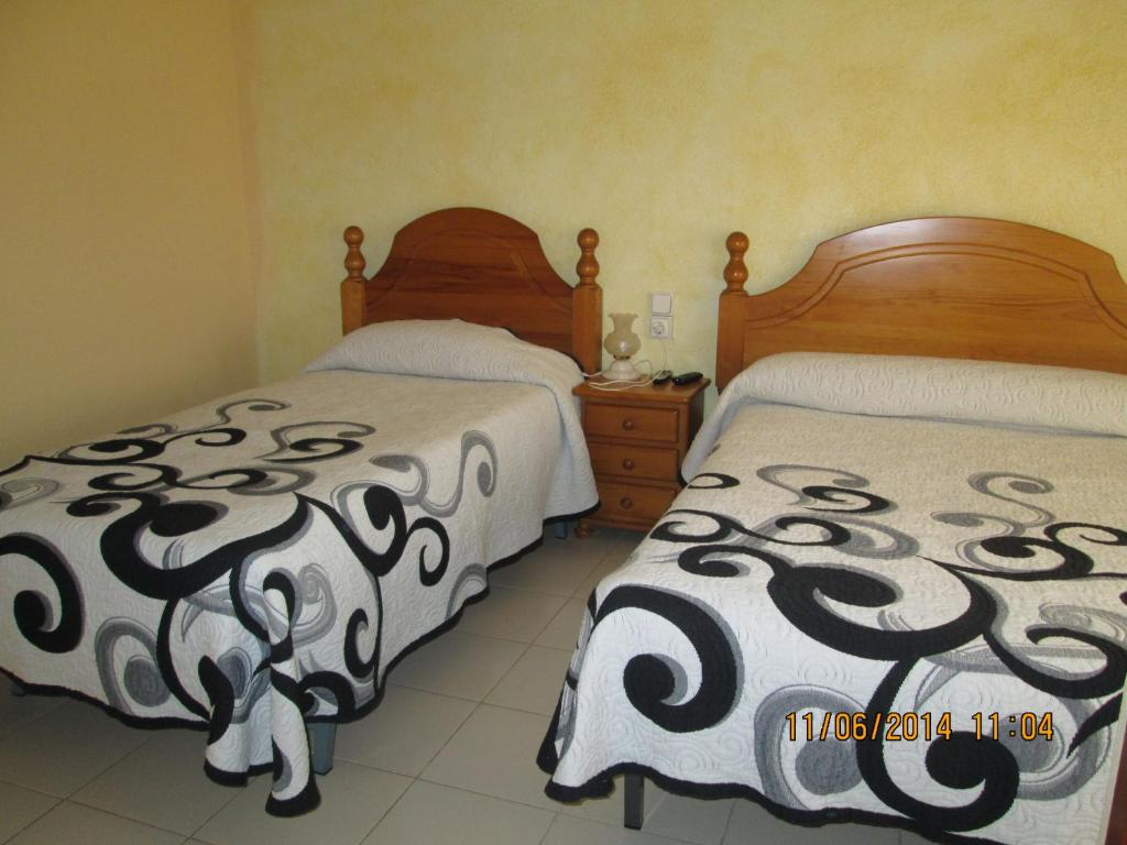 A bed or beds in a room at Pensio l'Avi Pep