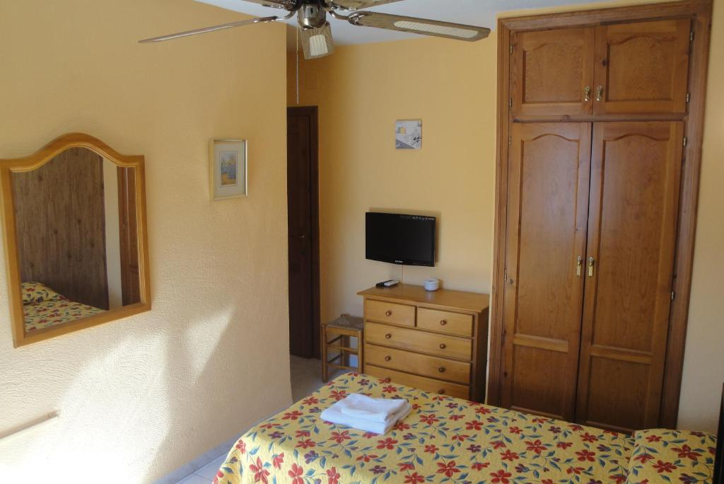 A television and/or entertainment center at Hostal Cristina